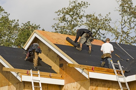 roofers repairing a roof in bucks county