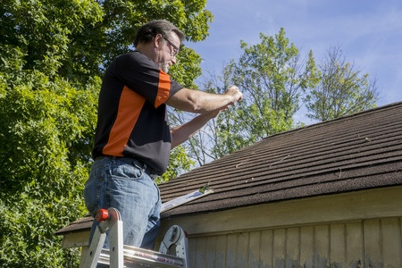 contractor taking photos of hail damaged roof in bucks county