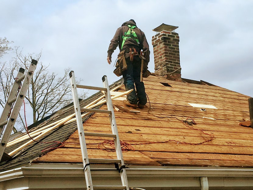 roofer on top of a roof working